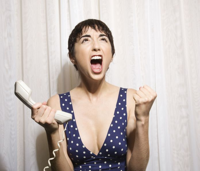Woman with phone screaming.